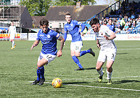 Connor Murray being closely watched by Andrew Steeves in the SPFL Ladbrokes Championship Play Off semi final match between Queen of the South and Montrose at Palmerston Park, Dumfries on  11.5.19.