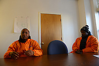 Cease Fire outreach workers and violence interrupters (l-r) Donya Smith, 26 and James Sima, 39 briefing in their office on recent developments in the neighborhoods where they work with at risk youth participants on the far South Side of Chicago, Illinois on February 3, 2017.  Cease Fire is a public health initiative that attempts to stop or halt gun violence across the city.