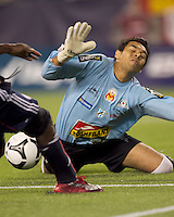 New England Revolution forward Kheli Dube (11) and Monarcas Morelia goalkeeper Jesus Urbina (12) action in the goal area. The New England Revolution defeated Monarcas Morelia in SuperLiga 2010 group stage match, 1-0, at Gillette Stadium on July 20, 2010.