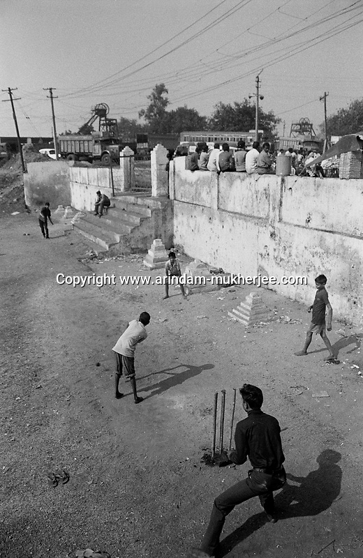 Children of coal miners playing cricket at a coal mining colony of Jharia, Jharkhand, India. Arindam Mukherjee