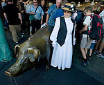 Dressed in early 1900's attire, Pippin Sardo, waits for a friend at Pike Place Market in Seattle on August 17, 2007. Tens of thousands turned out to help celebrate the 100th Anniversary of the market. For over a century a century, the Pike Place Market, has become a city institution and a national attraction, bringing in over a million tourists a year. .Jim Bryant Photo. ©2010. ALL RIGHTS RESERVED.