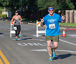 Steve Hatcher gestures as he heads towards the finish line during the 49th Annual Journal Jog in Reno, Nevada on Sunday, September 10, 2017.