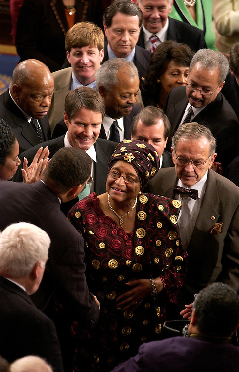 Ellen Johnson Sirleaf, president of the Republic of Liberia, greets the crowd in the House Chamber after she addressed a joint session of Congress.