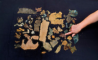 SAVEOCK WATER, CORNWALL, ENGLAND - AUGUST 03: A detail of textiles on August 3, 2008 in Saveock Water, Cornwall, England. They were found in a votive pool by archaeologist Jacqui Wood who dates them between the medieval period to the 17th century (no carbon dating). She is pointing to a high quality strip of silk and wool mix. (Photo by Manuel Cohen)