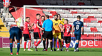 Lincoln City players, from left, Joe Morrell, Callum Connolly, Neal Eardley, Josh Vickers and Jack Payne speak to Referee Carl Boyeson after he awarded Bristol Rovers a penalty<br /> <br /> Photographer Chris Vaughan/CameraSport<br /> <br /> The EFL Sky Bet League One - Lincoln City v Bristol Rovers - Saturday 14th September 2019 - Sincil Bank - Lincoln<br /> <br /> World Copyright © 2019 CameraSport. All rights reserved. 43 Linden Ave. Countesthorpe. Leicester. England. LE8 5PG - Tel: +44 (0) 116 277 4147 - admin@camerasport.com - www.camerasport.com