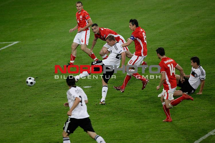 UEFA Euro 2008 Group B Klagenfurt - W&ouml;rthersee Match 04 <br /> <br /> Deutschland ( GER ) - Polen ( POL )<br /> <br /> 2:0 Lukas Podolski  (Bayern Muenchen #20) -li Pawel Golanski  ( Poland  / Verteidiger / Defender /  Steaua Bucuresti #04 ) Jakub Wawrzyniak  ( Poland  / Verteidiger / Defender /  Legia Warszawa #03 ) Jacek Bak  ( Poland  / Verteidiger / Defender /  Austria Wien #06 ) Michal Zewlakow  ( Poland  / Verteidiger / Defender /  Olympiakos Pir&auml;us #14 ) am boden deu11 vorne Mario Gomez ( Germany / Angreifer / Forward / VFB Stuttgart #9)<br /> Foto &copy; nph (  nordphoto  )<br /> <br /> <br /> <br />  *** Local Caption ***