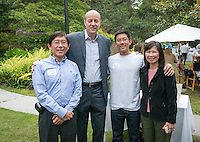 Austin Wang and his parents with Jonathan Veitch. Graduating seniors and their families and friends attend Brunch with President Jonathan Veitch at Collins House, May 16, 2015. (Photo by Marc Campos, Occidental College Photographer)