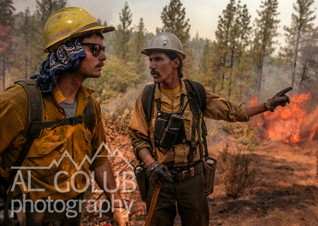 September 3, 1987 Pine Mountain Lake, California -- Stanislaus Complex Fire -- Stanislaus National Forest  foreman John Buckley gives orders to firefighter Joe Calderon to keep his eyes on the fire and stay safe. The Stanislaus Complex Fire consumed 28 structures and 145,980 acres.  One US Forest Service firefighter, David Ross Erickson, died from a tree-felling accident.