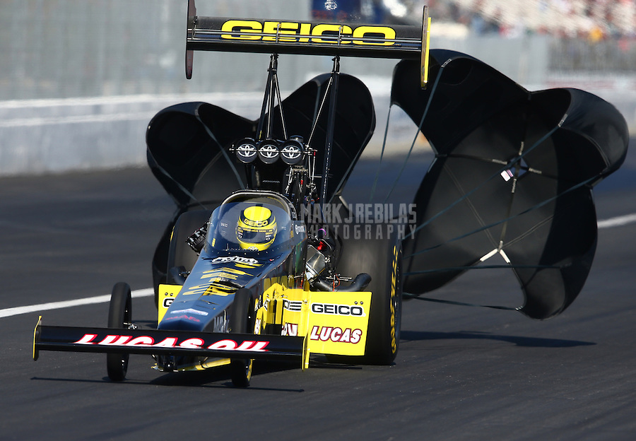 Feb 8, 2014; Pomona, CA, USA; NHRA top fuel dragster driver Richie Crampton during qualifying for the Winternationals at Auto Club Raceway at Pomona. Mandatory Credit: Mark J. Rebilas-
