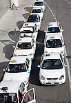 To be captioned after editing - Granada bus station, Malaga airport Line of white taxis queuing outside Malaga airport, Spain