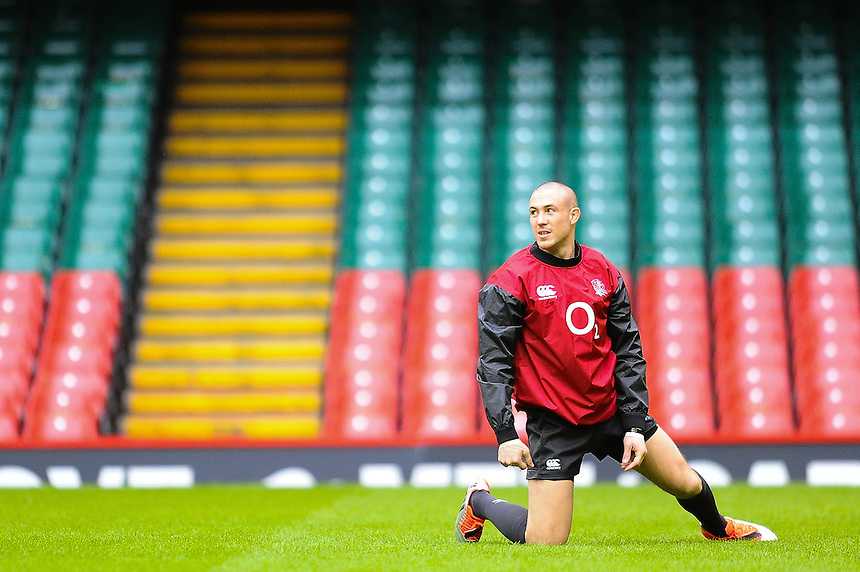 Englands&rsquo; Mike Brown stretching during todays training session <br /> <br /> Photographer Craig Thomas/CameraSport<br /> <br /> Rugby Union - 6 nations - England squad training - Thursday 5th Feburary - Millennium Stadium - Cardiff<br /> <br /> &copy; CameraSport - 43 Linden Ave. Countesthorpe. Leicester. England. LE8 5PG - Tel: +44 (0) 116 277 4147 - admin@camerasport.com - www.camerasport.com