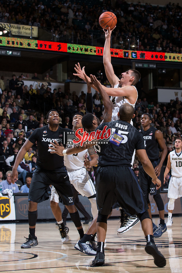 Dinos Mitoglou (44) of the Wake Forest Demon Deacons puts up a shot during first half action against the Xavier Musketeers at the LJVM Coliseum on December 22, 2015 in Winston-Salem, North Carolina.  The Musketeers defeated the Demon Deacons 78-70.  (Brian Westerholt/Sports On Film)