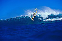 A windsurfer windsurfing at Hookipa beach park on Maui
