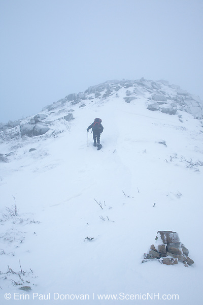 Winter hiker in whiteout conditions near the summit of Bondcliff during the winter months in the Pemigewasset Wilderness of the New Hampshire White Mountains.