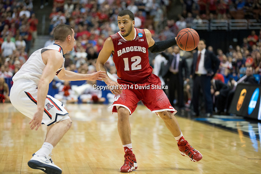 Wisconsin Badgers guard Traevon Jackson (12) handles the ball during the Western Regional Final NCAA college basketball tournament game against the Arizona Wildcats Saturday, March 29, 2014 in Anaheim, California. The Badgers won 64-63 (OT). (Photo by David Stluka)