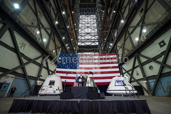 In this photo released by the National Aeronautics and Space Administration (NASA) Acting NASA Director, Robert Lightfoot, welcomes guests and introduces United States Vice President Mike Pence, Thursday, July 6, 2017, at the Vehicle Assembly Building at NASAís Kennedy Space Center (KSC) in Cape Canaveral, Florida. Vice President Mike Pence is also scheduled to speak at the event to highlight innovations made in America and tour some of the public/private partnership work that is helping to transform the center into a multi-user spaceport. Photo Credit: Aubrey Gemignani/NASA/CNP/AdMedia