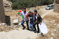 Un giornalista colpito dallo spray al peperoncino dell'esercito israeliano<br /> Jabba 02-07-2015 Manifestazione palestinese sulla strada per l'insediamento di Adam, nel primo anniversario dell'uccisione del sedicenne Mohammed Abu Khder, che fu bruciato vivo da estermisti israeliani. Questo innesco' una spirale di violenza che porto' alla guerra dei 50 giorni del 2014<br /> A journalist reacts after Israeli security forces sprayed his face with pepper gas, as he was covering a demonstration by Palestinians on a road leading to the Adam settlement, located near the West Bank village of Jabba, to mark the first anniversary of the killing of 16-year-old Palestinian Mohammed Abu Khder, who was snatched and burned alive by Jewish extremists after the murder of three Israeli teenagers. The murder by Palestinians of the three Israeli teenagers and the grisly revenge killing of Khder triggered events that led to war in the Gaza Strip in 2014<br /> PhotoCredit: EXPA/ APAimages/ Ashraf Amra<br /> <br /> *****ATTENTION - for AUT, GER, SUI, ITA, POL, CRO, SRB only*****