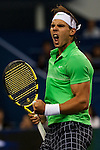 SHANGHAI, CHINA - OCTOBER 14:  Rafael Nadal of Spain celebrates after winning his match against James Blake of the United States during day four of 2009 Shanghai ATP Masters 1000 at the Qi Zhong Tennis Centre in Shanghai. Photo by Victor Fraile / The Power of Sport Images