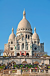 Sacre-Coeur sits on the highest point of Paris; the church was built as a memorial for the soliders killed during the Franco-Prussian War and took 38 years to build; Paris, France