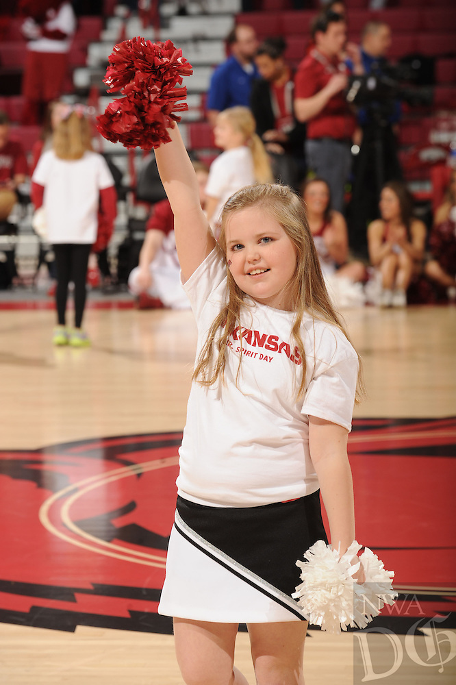 NWA Democrat-Gazette/ANDY SHUPE - Ella Fisher, 9, of Bentonville cheers with members of the University of Arkansas cheer squads Sunday, Jan. 11, 2015, during halftime of the Razorbacks women's basketball game against Tennessee in Bud Walton Arena in Fayetteville. Ella was participating in the Junior Spirit Day at the game and performed after a cheer clinic earlier in the day.