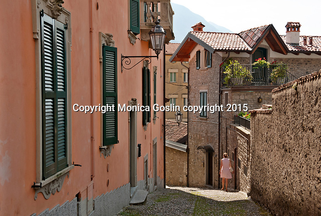 Cobble stone path that leads to the ferry stop in Varenna, a town on Lake Como, Italy