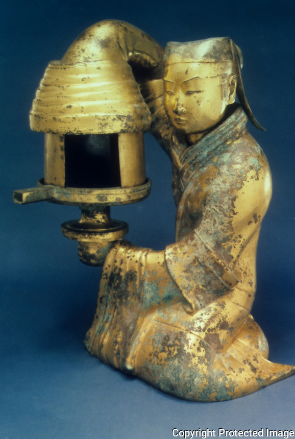 """China:  Gilt-bronze lamp, Western Han, first half 2nd C. B.C.  18 7/8""""  high. Hebei Provincial Museum.  Great Bronze Age of China--exhibition."""