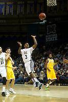Michael Dyson (#3) scores the winning basket against NAU Lumberjacks at the buzzer. The Bobcats won the game 68-66.