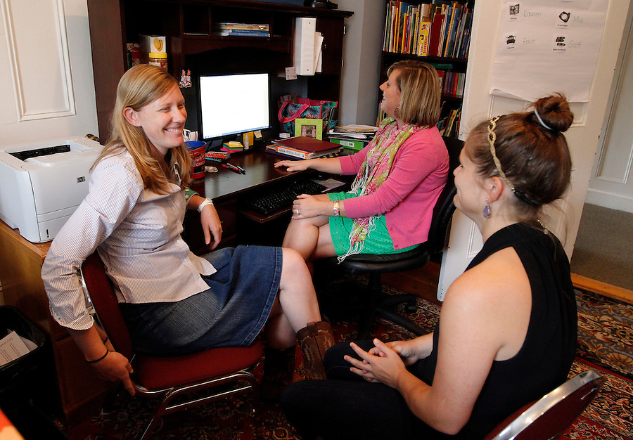 From left, preschool editors Carolyn Gosse, Lauren Simmons and Elizabeth Pettit hold a group practice session of the read aloud a teacher would have in their classroom Wednesday August 28, 2013 at the Core Knowledge Foundation in Charlottesville, VA. The session allows the editors to verbally listen to how their words sound in a classroom read aloud and gives the editors a chance to make the read aloud more interactive. Photo/Andrew Shurtleff