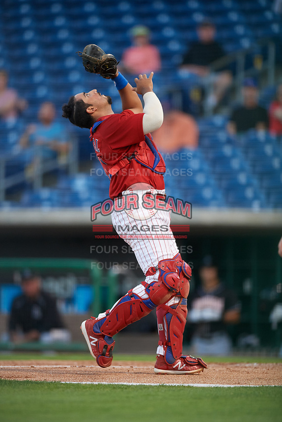 Clearwater Threshers catcher Edgar Cabral (30) settles under a pop up during a game against the Jupiter Hammerheads on April 12, 2018 at Spectrum Field in Clearwater, Florida.  Jupiter defeated Clearwater 8-4.  (Mike Janes/Four Seam Images)
