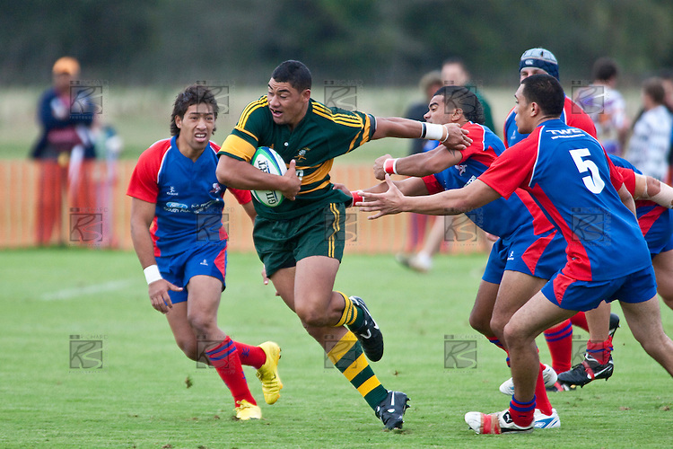Maania Vaipulu breaks through the the wall of Ardmore Marist defenders. Counties Manukau Premier Club Rugby game between Ardmore Marist and Pukekohe played at Bruce Pulman Park on Saturday April 17th..Pukekohe won the game 25 - 0 after leading 15 - 0 at halftime.