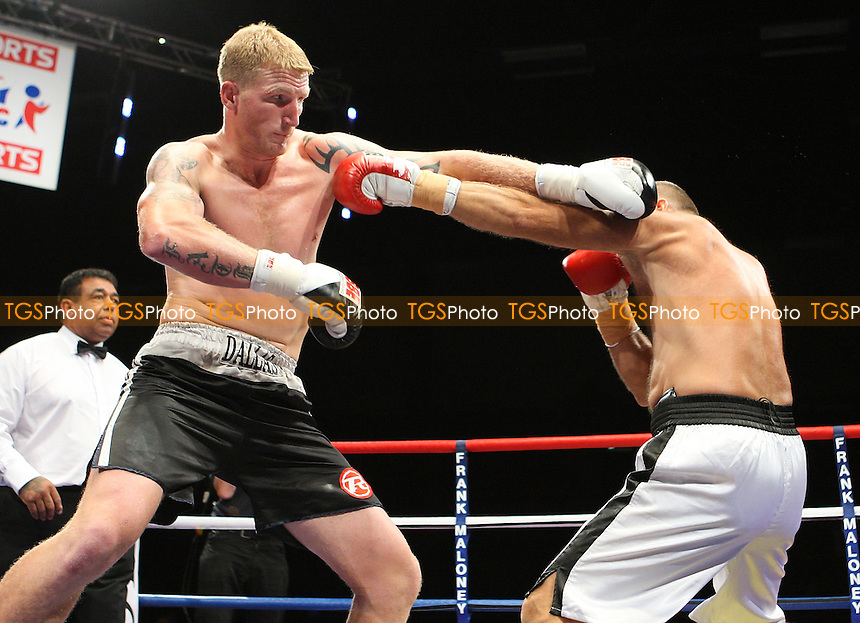 Tom Dallas (black shorts) defeats Mihaly Nemet in a Heavyweight Boxing contest at the Brentwood International Centre, promoted by Maloney Promotions - 11/09/09 - MANDATORY CREDIT: Gavin Ellis/TGSPHOTO - Self billing applies where appropriate - Tel: 0845 094 6026
