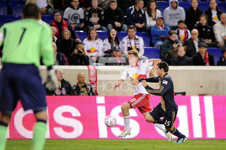 Jan Gunnar Solli (8) of the New York Red Bulls is defended by Gabriel Farfan (15) of the Philadelphia Union. The New York Red Bulls defeated the Philadelphia Union  1-0 during a Major League Soccer (MLS) match at Red Bull Arena in Harrison, NJ, on October 20, 2011.