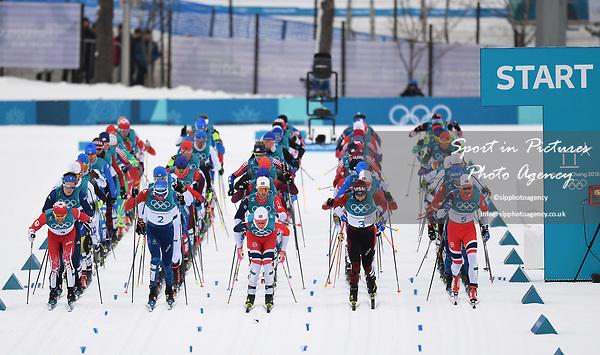 The massed start. Mens 15km Skiathlon. Cross country skiing. Pyeongchang2018 winter Olympics. Alpensia cross country centre. Alpensia. Gangneung. Republic of Korea. 11/02/2018. ~ MANDATORY CREDIT Garry Bowden/SIPPA - NO UNAUTHORISED USE - +44 7837 394578