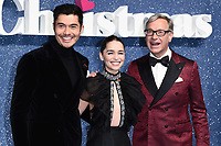 """LONDON, UK. November 11, 2019: Henry Golding, Emelia Clarke and Paul Feig arriving for the """"Last Christmas"""" premiere at the BFI Southbank, London.<br /> Picture: Steve Vas/Featureflash"""