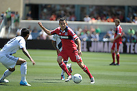Chicago midfielder Marco Pappa (16) is defended by LA Galaxy defender A.J. DeLaGarza (20).The LA Galaxy defeated the Chicago Fire 2-0 at Toyota Park in Bridgeview, IL on July 8, 2012.