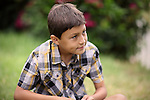Young boy in Meadow looking off camera - copy space - Exclusively available here