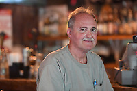 NWA Democrat-Gazette/J.T. WAMPLER T.L. Nelms, owner of the Restaurant on the Corner in Fayetteville sits in the bar side of the business May 17, 2017.