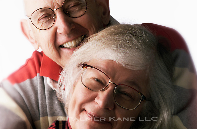 White senior couple portrait, looking into the camera