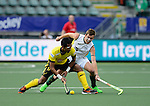 The Hague, Netherlands, May 31: Razie Abd Rahim #17 of Malaysia and Jacob Whetton #12 of Australia battle for the ball during the field hockey group match (Group A) between Australia and Malaysia on May 31, 2014 during the World Cup 2014 at Kyocera Stadium in The Hague, Netherlands. Final score 4:0 (1:0) (Photo by Dirk Markgraf / www.265-images.com) *** Local caption ***