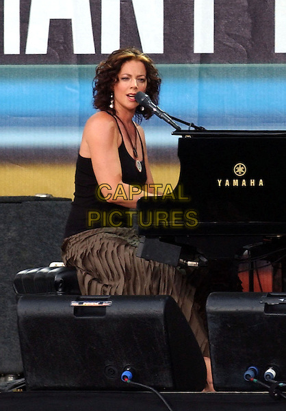 July 2, 2005 - Philadelphia, Pennsylvania - Sarah McLachlan. Live 8 is a series of nine concerts taking place in Philadelphia, London, Paris, Berlin, Rome, Tokyo, Toronto, Johannesburg and Moscow on four continents on the same day to raise awareness to call for an end to extreme poverty in Africa. Photo Credit: Laura Farr/AdMedia