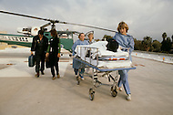 Los Angeles, U.S.A, January, 1983. Patient arriving on the roof of the Sherman Oaks Hospital, a center  specializing in the treatment of seriously burned patients.