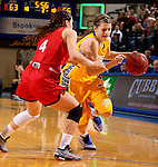 BROOKINGS, SD - FEBRUARY 21:  Macy Miller #12 from South Dakota State drives against Tia Hemiller #4 from the University of South Dakota in the second half of their game Saturday evening at Frost Arena in Brookings. (Photo by Dave Eggen/Inertia)