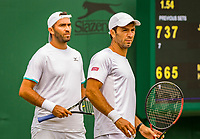 London, England, 8 July, 2019, Tennis,  Wimbledon, Men's doubles Jean-Julian Rojer (NED) and Horia Tecau (ROU) (L)<br /> Photo: Henk Koster/tennisimages.com
