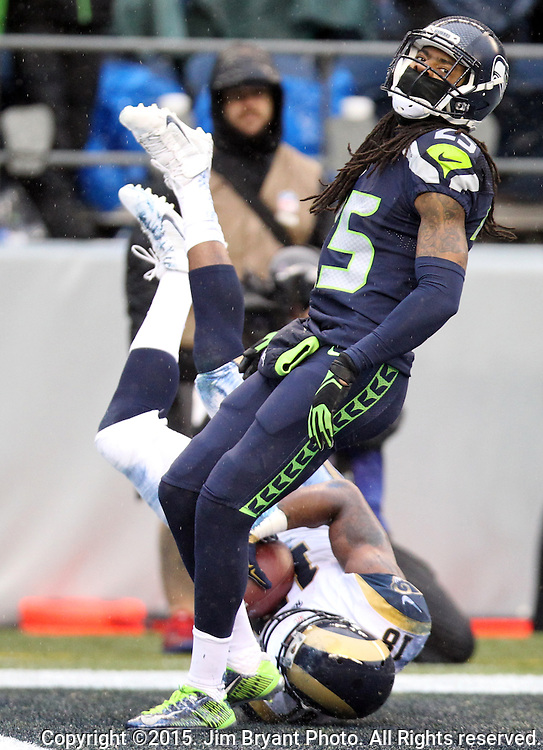 Seattle Seahawks cornerback Richard Sherman (25) reacts to St. Louis Rams wide receiver Kenny Britt (18) scoring a touchdown at CenturyLink Field in Seattle, Washington on December 27, 2015.  The Rams beat the Seahawks 23-17.      ©2015. Jim Bryant Photo. All Rights Reserved