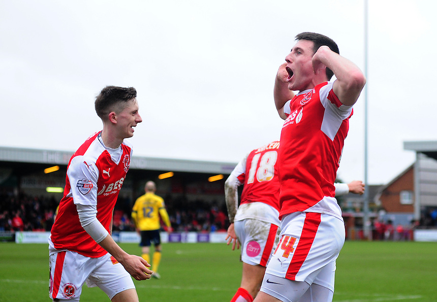 Fleetwood Town's Bobby Grant celebrates scoring his sides second goal infant of the Scunthorpe United fans <br /> <br /> Photographer Chris Vaughan/CameraSport<br /> <br /> Football - The Football League Sky Bet League One - Fleetwood Town v Scunthorpe United  - Saturday 20th February 2016 - Highbury Stadium - Fleetwood    <br /> <br /> &copy; CameraSport - 43 Linden Ave. Countesthorpe. Leicester. England. LE8 5PG - Tel: +44 (0) 116 277 4147 - admin@camerasport.com - www.camerasport.com