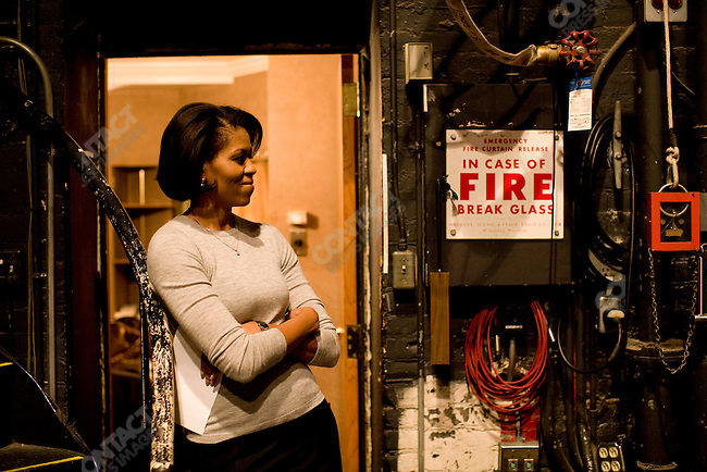 Michelle Obama, wife of Democratic presidential candidate Barack Obama, waits in the wings of the Pabst Theater to deliver a speech promoting her husband's campaign. Milwaukee, Wisconsin, February 18, 2008.