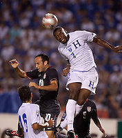 Osman Chavez (2) heads the ball over Landon Donovan (10). US Men's National Team vs Honduras at Estadio Olimpico in San Pedro Sula, Honduras.