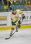 16 November 2013: University of Vermont Catamount Defenseman Nick Bruneteau, a Senior from Omaha, NB, in action against the Providence College Friars at Gutterson Fieldhouse in Burlington, Vermont. The Friars shut out the Catamounts to sweep the 2-game weekend Hockey East Series. Mandatory Credit: Ed Wolfstein Photo *** RAW (NEF) Image File Available ***