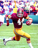 Washington Redskins running back John Riggins (44) carries the ball against the St. Louis Cardinals at RFK Stadium in Washington, D.C. on Sunday, October 2, 1977.  The Redskins won the game 24 - 14..Credit: Arnie Sachs / CNP.