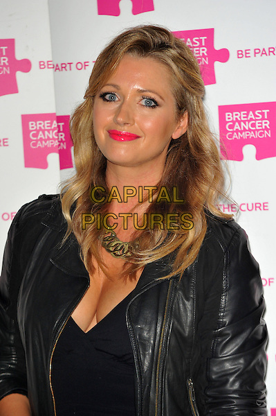 Hayley McQueen.The launch party for Breast Cancer Campaign at Tower 42, London, England..October 1st, 2012 .headshot portrait cleavage pink lipstick  black blue leather jacket gold necklace .CAP/CJ.©Chris Joseph/Capital Pictures.